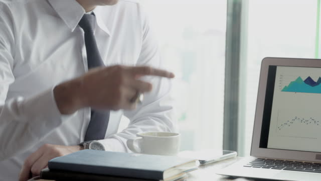 Two senior businessman planning target finance from statistic graph on laptop computer in the office, manager meeting and discussion and analysis from information chart of sales for marketing. Two senior businessman planning target finance from statistic graph on laptop computer in the office, manager meeting and discussion and analysis from information chart of sales for marketing. employee engagement stock videos & royalty-free footage