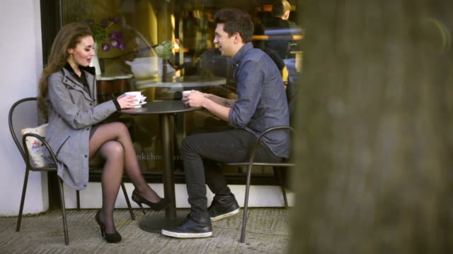 Two shot of cute couple on date outside coffee shop video