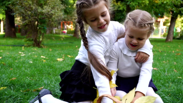 Two sisters in an autumn park video