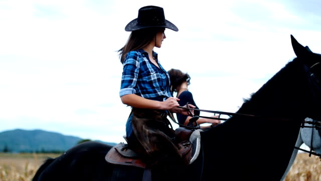 two sisters riding horses outdoors in slow mo - ranch video stock e b–roll