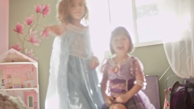 Two sisters wearing princess dresses run down a hallway and into a room in slow motion Two sisters wearing princess dresses run down a hallway and into a room in slow motion princess stock videos & royalty-free footage