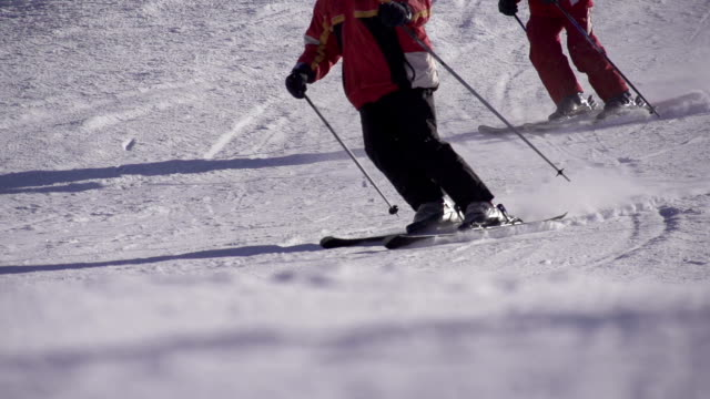 SLOW MOTION: Two skiers skiing on the slope video