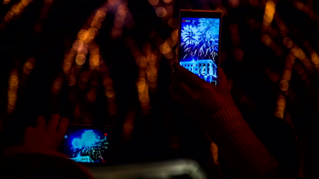 Two Spectators Filming Fireworks Using Smartphones video
