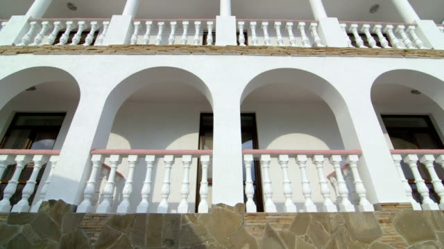 two storey house exterior with classic white balustrade balcony tilt up - balaustrata video stock e b–roll