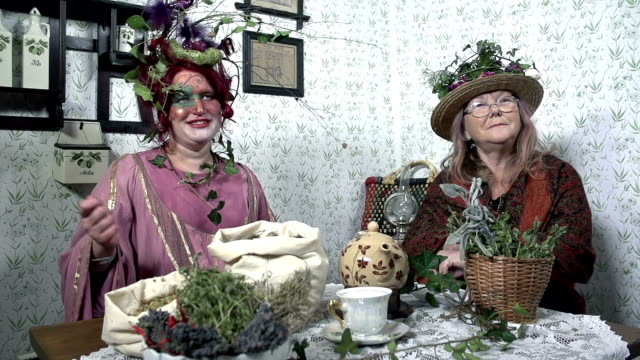 HD-SLOW: Two strange ladies surrounded with various plants video
