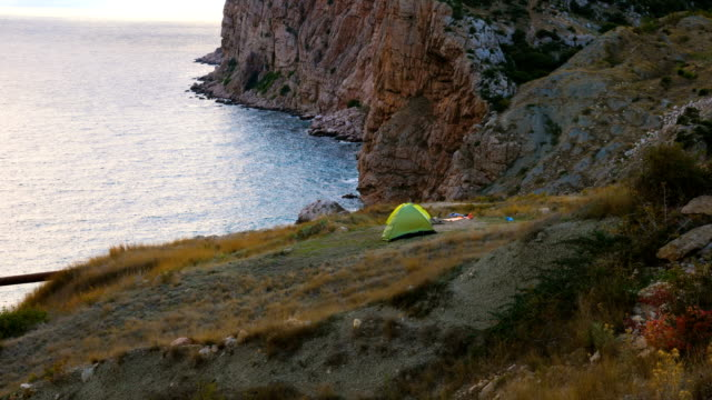 Two tourist tents in the mountains.