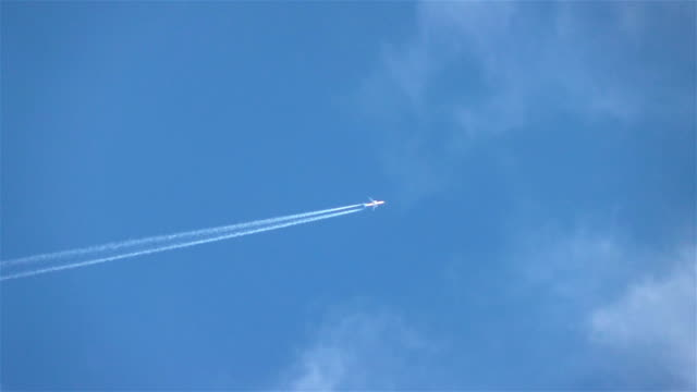 Two videos of airplane in the sky in real slow motion video