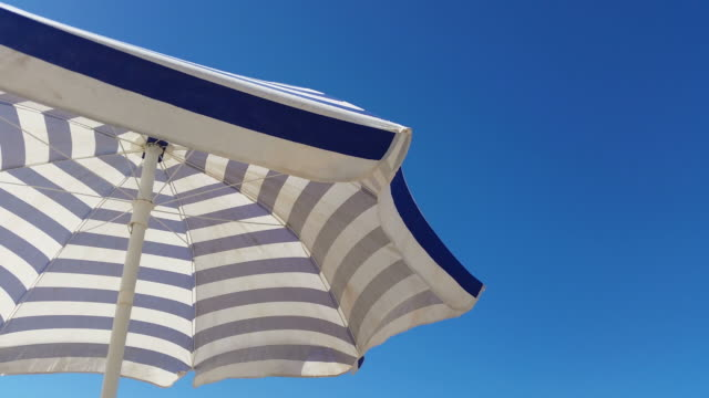 Two videos of beach umbrella in 4K video