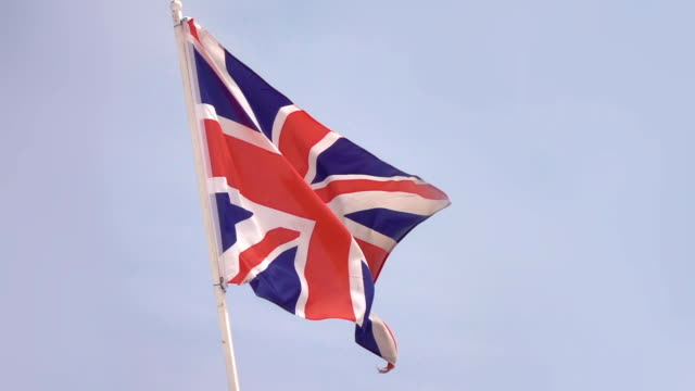 Two videos of British flag in real slow motion video