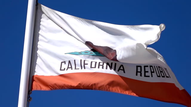Two videos of california flag in real slow motion video