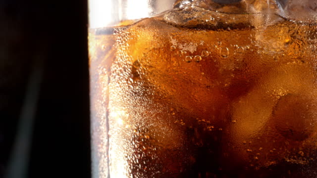 Two videos of cold cola in 4K Two videos of cold cola with ice cubes in 4K soda stock videos & royalty-free footage