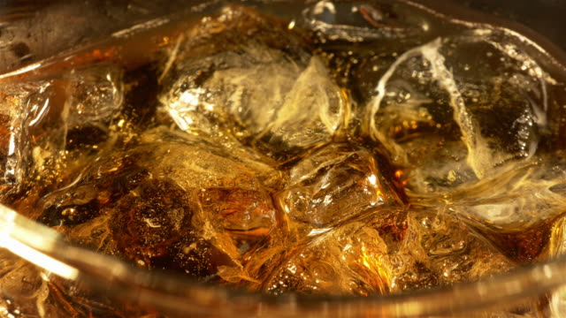 Two videos of cold cola with ice cubes in 4K Two high quality videos of cold cola with bubbles in 4K tasting stock videos & royalty-free footage