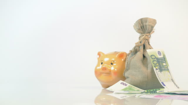 Two videos of falling money in 4K video
