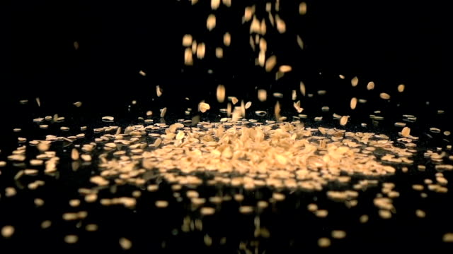Two videos of falling oatmeal in real slow motion video