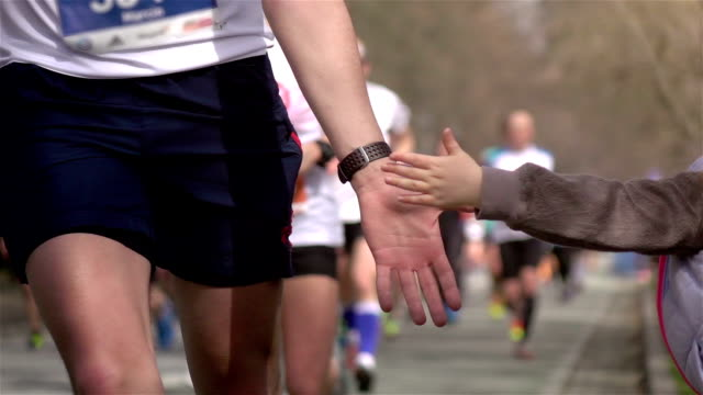 Two videos of giving runners high five -real slow motion video