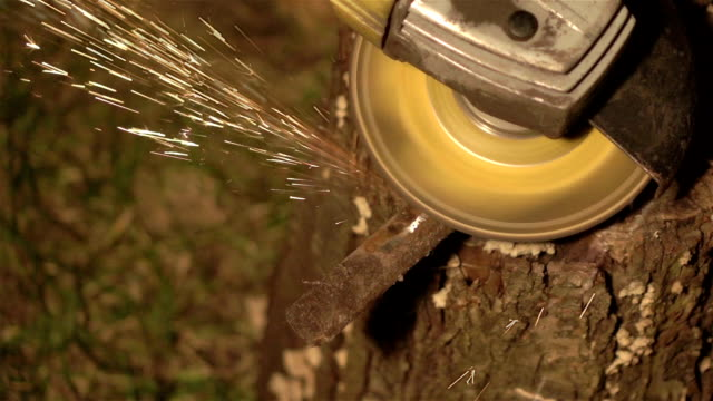 Two videos of grinder sparks in real slow motion video
