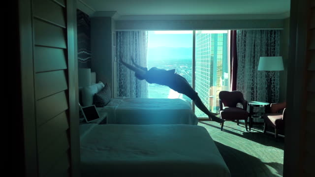 Two videos of man jumping on the bed in real slow motion video