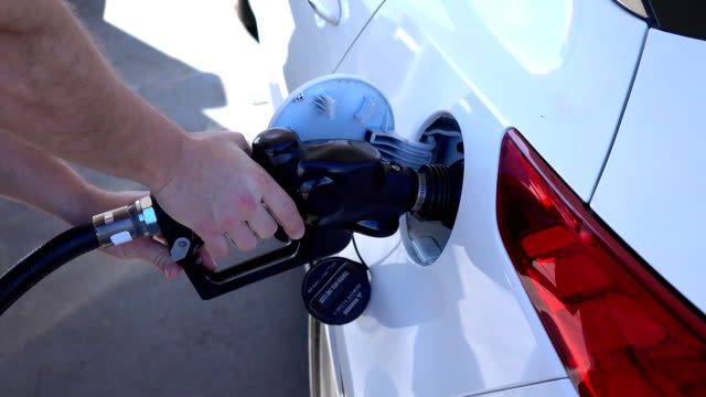 Two videos of man refueling the car in 4K video