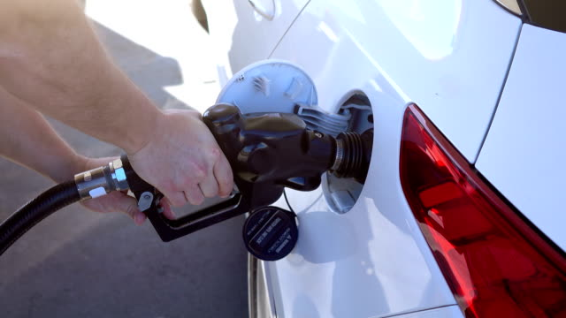 Two videos of man refueling the car in 4K