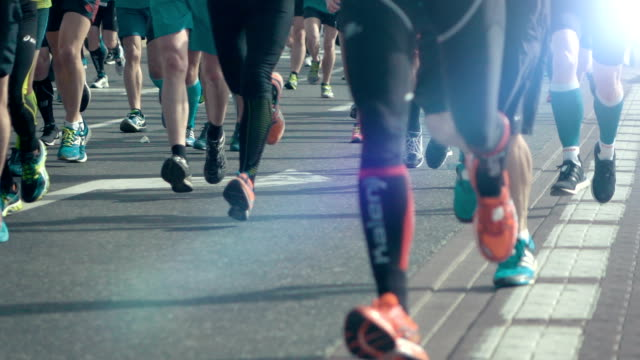 Two videos of marathon runners in real slow motion video