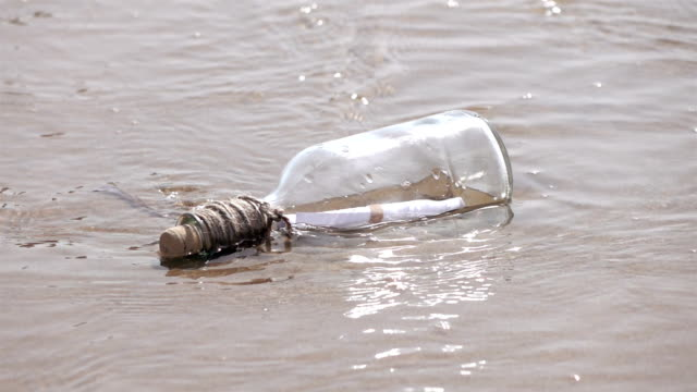 Two videos of message in the bottle in the water-slow motion Two high quality videos of message in the bottle in the water in real 1080p slow motion 250fps.  cork stopper stock videos & royalty-free footage