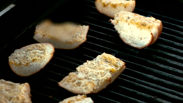 Two videos of pieces of bread on the grill in real slow motion video