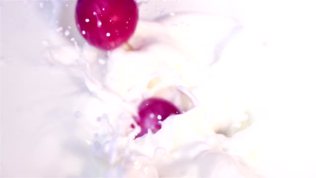 Two videos of radish falling into milk -real slow motion video