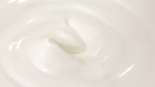 Two videos of scooping yogurt in 4K video