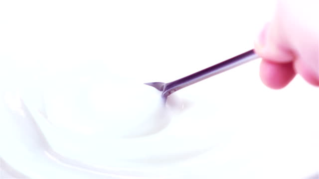 Two videos of scooping yogurt in real slow motion video
