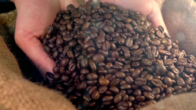 Two videos of showing coffee beans in real slow motion video