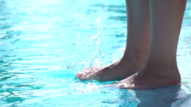 two videos of tramping on the water -real slow motion - dito del piede video stock e b–roll