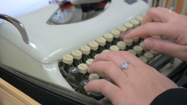 Two videos of typewriter in 4K