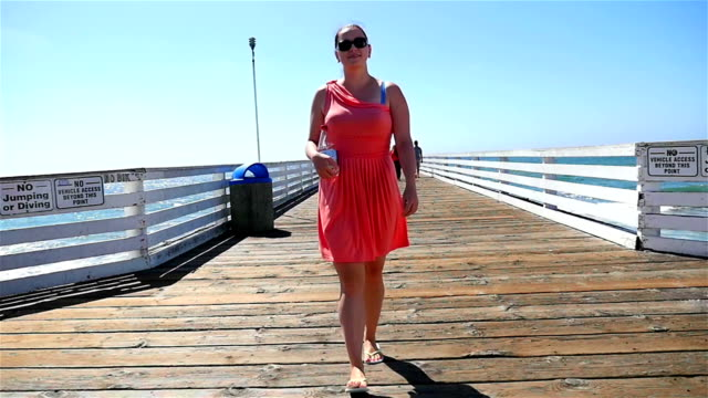Two videos of woman in California in slow motion video