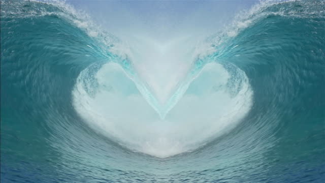 SLOW MOTION: Two waves making a beautiful heart formation video