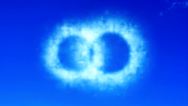 two wedding ring from cloud on sky