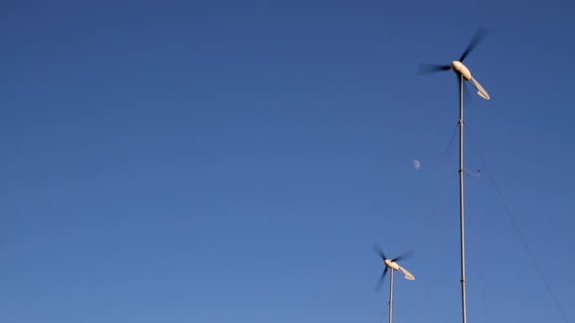 Two Wind Turbines With Half Moon HD video