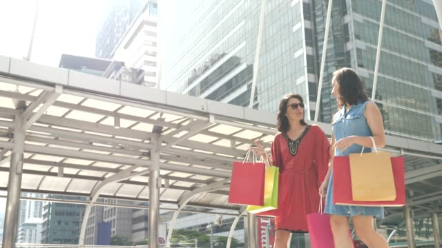 Two Woman Friends Shopping walking with Shopping bag