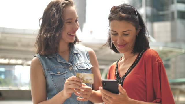 Two woman online shopping on Smart phone