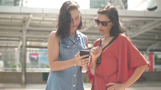 Two woman using smart phone