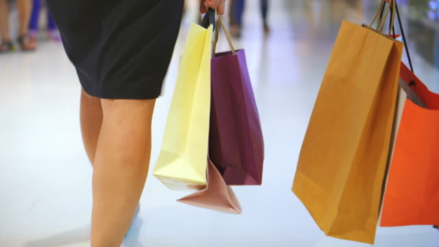 Two Women Carrying Shopping Bag In The Mall video