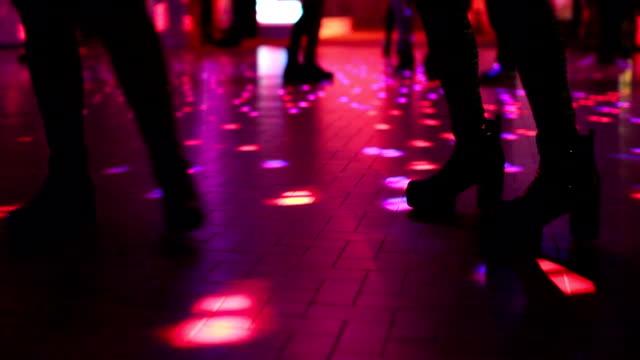 two women dancing in disco video