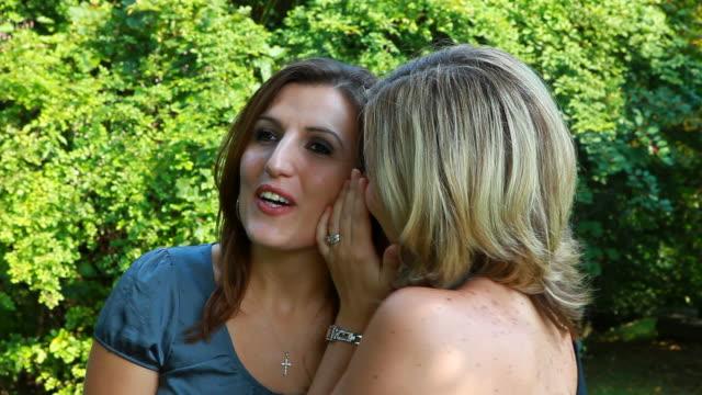 Two women gossiping video