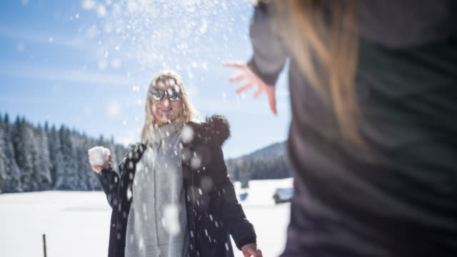 Two women having a snowball fight video