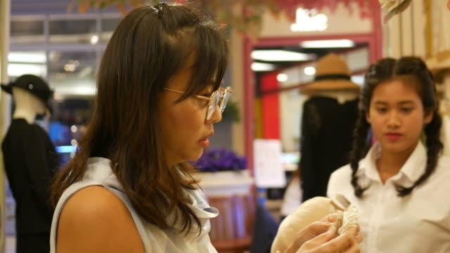 Two women having fun shopping in boutique video