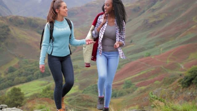 Two Women Hiking Up Mountain video