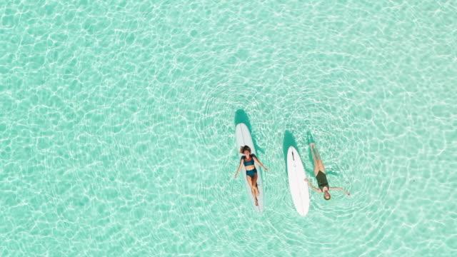 Two women on paddle board in lagoon