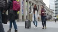istock Two women on vacation walking on city sidewalk 1218659234