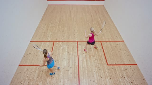 two women playing squash in a nice new court - taking a shot sport stock videos & royalty-free footage