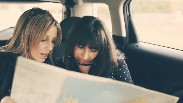 Two Women Reading Map in the car video