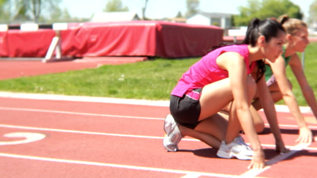 Two women start track race Two women start track race less than 10 seconds stock videos & royalty-free footage